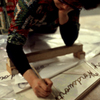 Picture of Judy Chicago writing Heritage Floor names